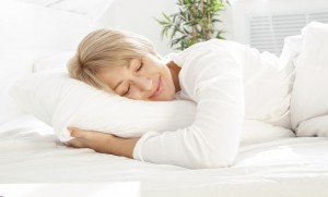 sleeping-lady-in-white-bed-300x181