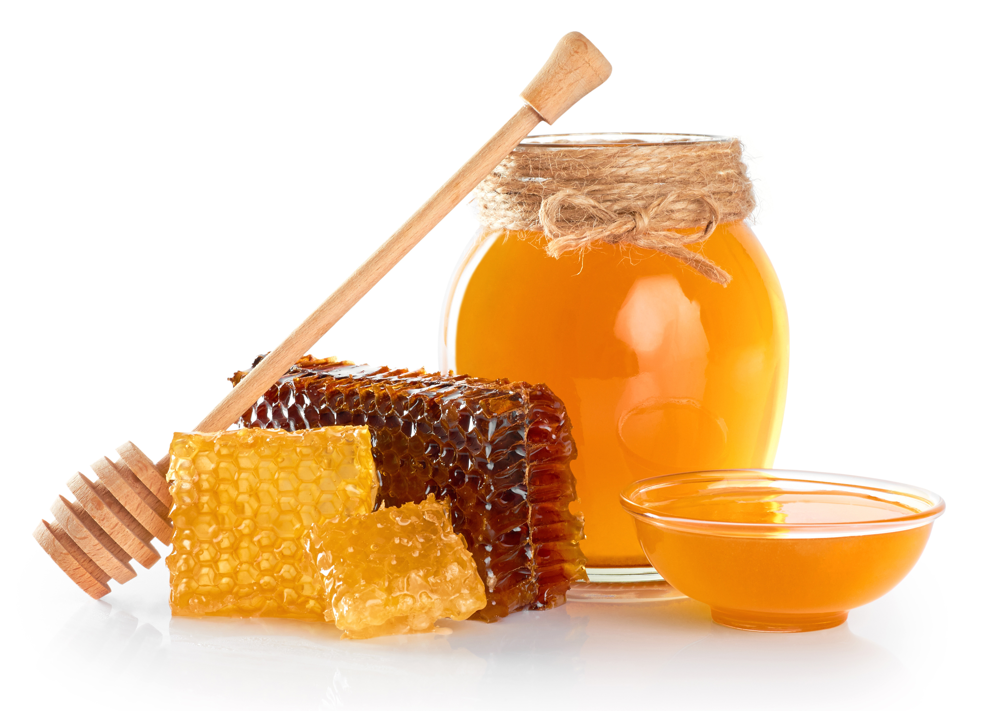 Fresh honey with honeycomb isolated on white background. Honey dipper.